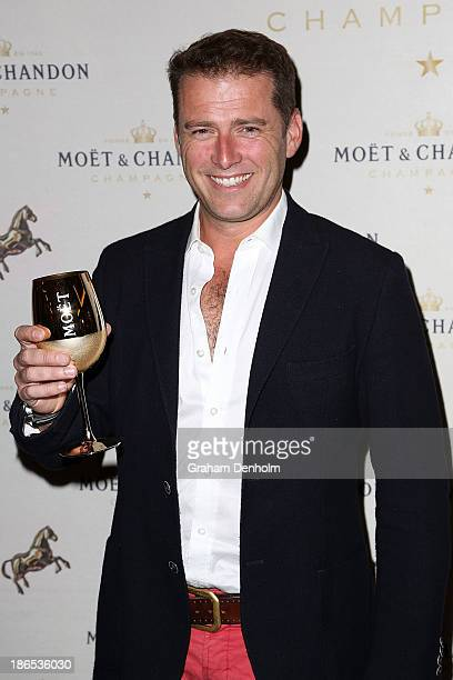 TV personality Karl Stefanovic poses at the Moet Chandon Derby Eve party held at The Waiting Room Crown Towers on November 1 2013 in Melbourne...