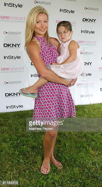 TV personality Kelly Ripa and daughter Lola arrive at 'Super Saturday in the Hamptons' at Nova's Ark Project on July 31 2004 in Watermill New York