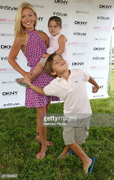 TV personality Kelly Ripa arrives with son Michael and holds daughter Lola at 'Super Saturday in the Hamptons' at Nova's Ark Project on July 31 2004...