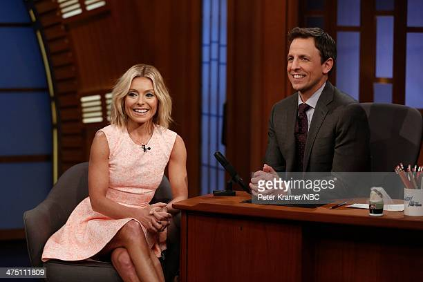 Personality Kelly Ripa sits for an interview with host Seth Meyers during NBC's 'Late Night with Seth Meyers' on February 26 2014 in New York City