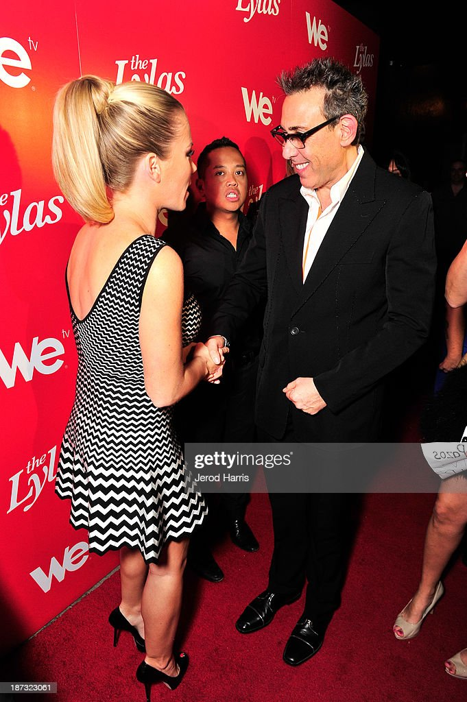 TV personality Kendra Wilkinson (L) and president and general manager of WE tv, Marc Juris are seen at WE tv's Celebration for The Premiere Of It's Newest Series 'The LYLAS' at the Warwick on November 7, 2013 in Hollywood, California.