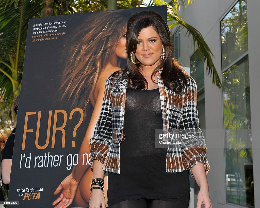TV personality Khloe Kardashian unveils her PETA 'Fur? I'd Rather Go Naked' billboard on December 10, 2008 in Los Angeles, California.