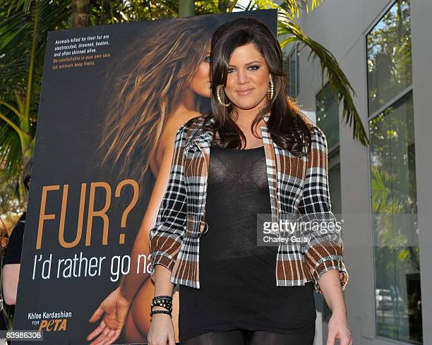 TV personality Khloe Kardashian unveils her PETA Fur I'd Rather Go Naked billboard on December 10 2008 in Los Angeles California