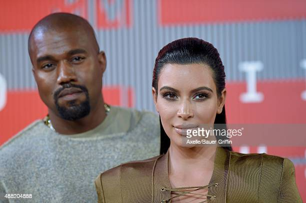 TV personality Kim Kardashian and recording artist Kanye West arrive at the 2015 MTV Video Music Awards at Microsoft Theater on August 30 2015 in Los...