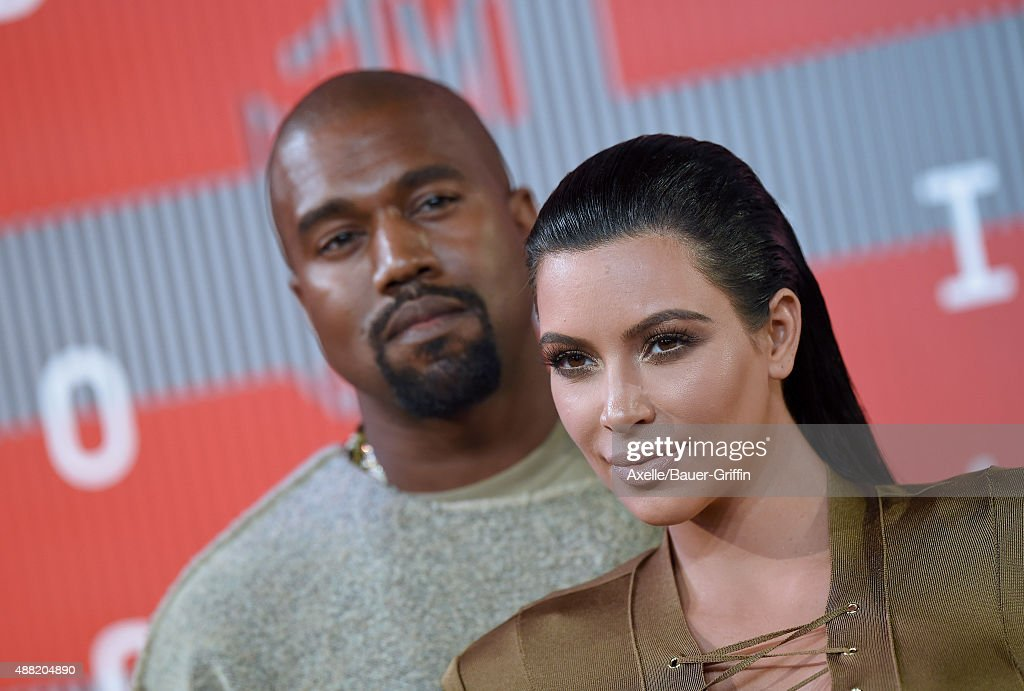 TV personality Kim Kardashian and recording artist Kanye West arrive at the 2015 MTV Video Music Awards at Microsoft Theater on August 30, 2015 in Los Angeles, California.