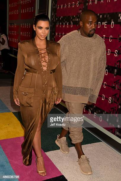 TV personality Kim Kardashian and recording artist Kanye West attend the 2015 MTV Video Music Awards at Microsoft Theater on August 30 2015 in Los...