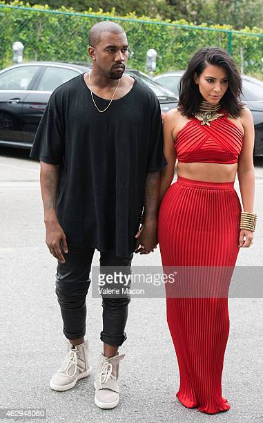 TV personality Kim Kardashian and recording artist Kanye West speculated to be wearing the Yeezy 3 sneakers 'Yeezy 750 Boost' arrive at the Roc...
