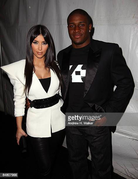 TV personality Kim Kardashian and Reggie Bush of the New Orleans Saints pose backstage at the Y3 Autumn/Winter 200910 fashion show during...