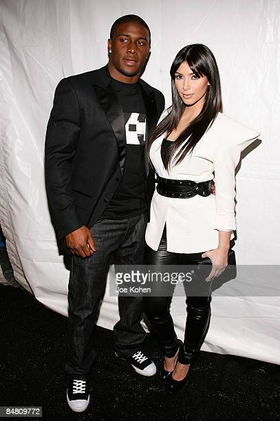 Personality Kim Kardashian and Reggie Bush of the New Orleans Saints attend Y-3 Fall 2009 during Mercedes-Benz Fashion Week at Pier 40 on February...
