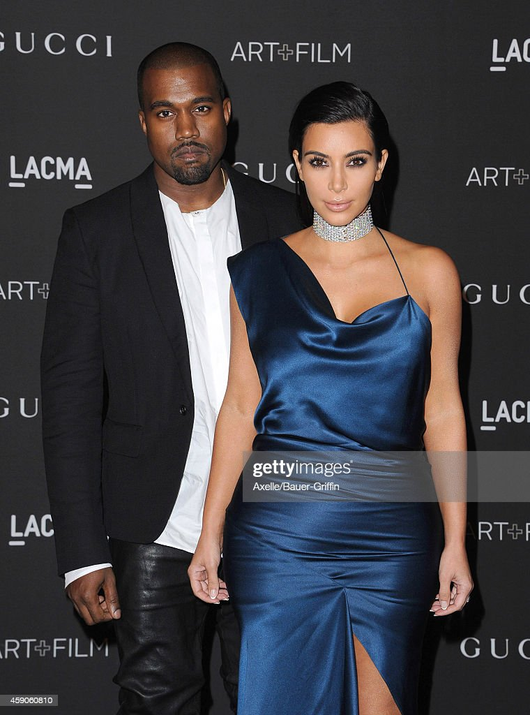 TV personality Kim Kardashian and singer Kanye West attend the 2014 LACMA Art + Film Gala Honoring Barbara Kruger And Quentin Tarantino Presented By Gucci at LACMA on November 1, 2014 in Los Angeles, California.