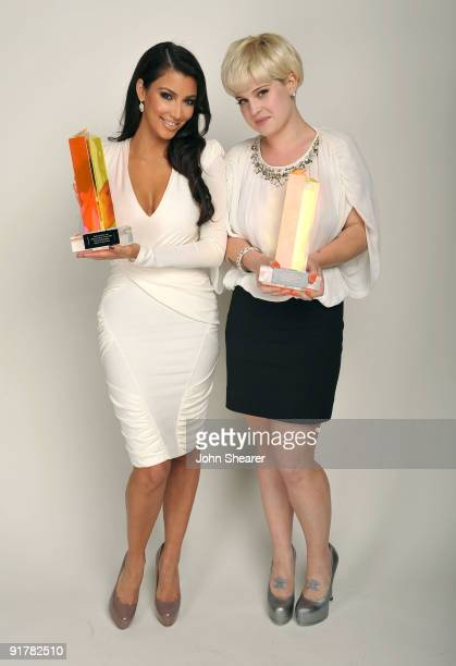 TV personality Kim Kardashian and singer Kelly Osbourne pose for a portrait at Hollywood Life's 6th Annual Hollywood Style Awards held at the Armand...