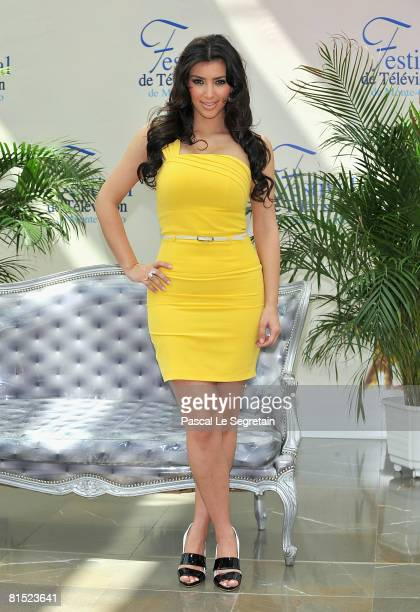 """Personality Kim Kardashian attends a photocall promoting the television series """"Keeping Up With the Kardashians"""" on the fourth day of the 2008 Monte..."""