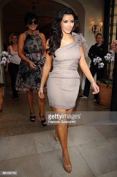 TV personality Kim Kardashian leaves the Hermitage Hotel with her mother Kris Jenner during the 49th MonteCarlo TV Festival on June 9 2009 in...
