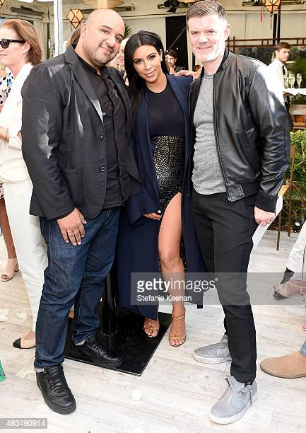 TV personality Kim Kardashian poses with CADET's Raul Arevalo and Brad Schmidt at CFDA/Vogue Fashion Fund Show and Tea at Chateau Marmont on October...