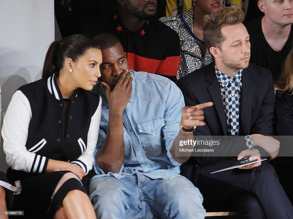 TV Personality Kim Kardashian, Rapper Kanye West and Derek Blasberg attend Louise Goldin Spring 2013 at Milk Studios on September 12, 2012 in New York City.