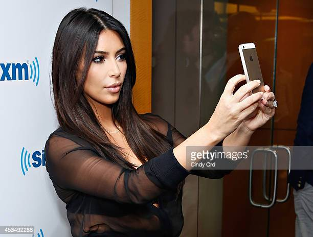 TV personality Kim Kardashian takes a selfie at the SiriusXM Studios on August 11 2014 in New York City