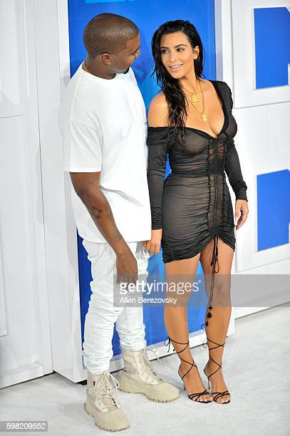 TV personality Kim Kardashian West and recording artist Kanye West arrive at the 2016 MTV Video Music Awards at Madison Square Garden on August 28...