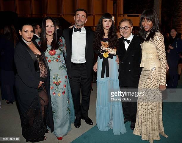 Personality Kim Kardashian West, Art Film Gala co-chair and LACMA Trustee Eva Chow, wearing Gucci,, designer Riccardo Tisci, musician Asia Chow,...