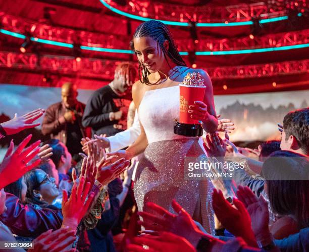 TV personality Kim Kardashian winner of the Best Reality Series/Franchise award for 'Keeping Up with the Kardashians' walks off stage during the 2018...