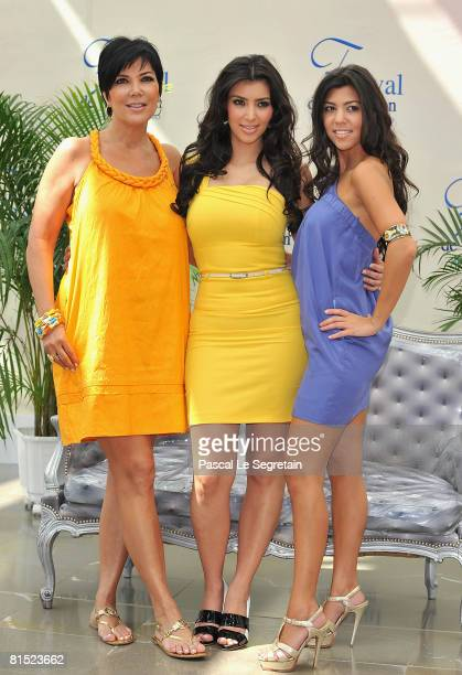 "Personality Kim Kardashian with her mother Kris and sister Kourtney attend a photocall promoting the television series ""Keeping Up With the..."