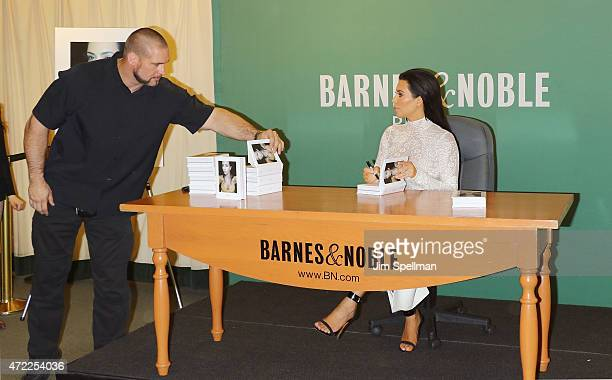 Personality Kim Kardashian with security guard Pascal Duvier sign copies cf 'Selfish' at Barnes Noble 5th Avenue on May 5 2015 in New York City