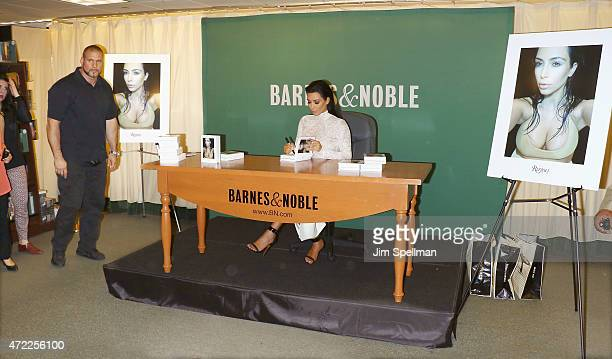 Personality Kim Kardashian with security guard Pascal Duvier signs copies cf 'Selfish' at Barnes Noble 5th Avenue on May 5 2015 in New York City