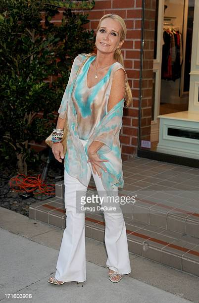 TV personality Kim Richards of The Real Housewives of Beverly Hills arrives at a fashion fundraiser hosted by Kyle Richards benefiting Children's...