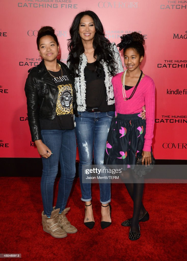 TV personality Kimora Lee Simmons (C) and daughters arrives at the premiere of Lionsgate's 'The Hunger Games: Catching Fire' at Nokia Theatre L.A. Live on November 18, 2013 in Los Angeles, California.