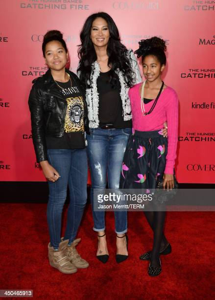 TV personality Kimora Lee Simmons and daughters arrives at the premiere of Lionsgate's 'The Hunger Games Catching Fire' at Nokia Theatre LA Live on...