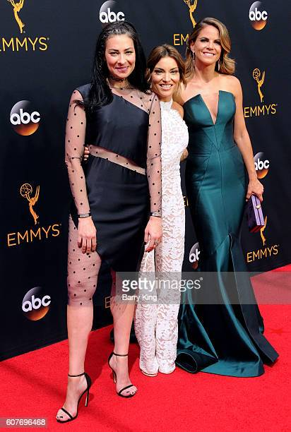 TV personality Kit Hoover and Natalie Morales and guest attend the 68th Annual Primetime Emmy Awards at Microsoft Theater on September 18 2016 in Los...