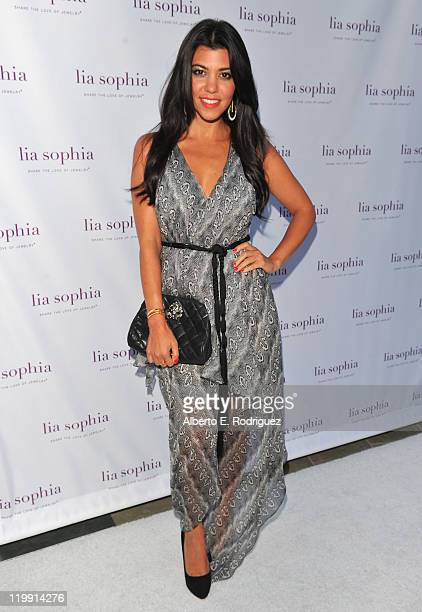 TV personality Kourtney Kardashian arrives to the unveiling of lia sophia's latest jewelry creations at the Sunset Marquis Hotel on July 26 2011 in...