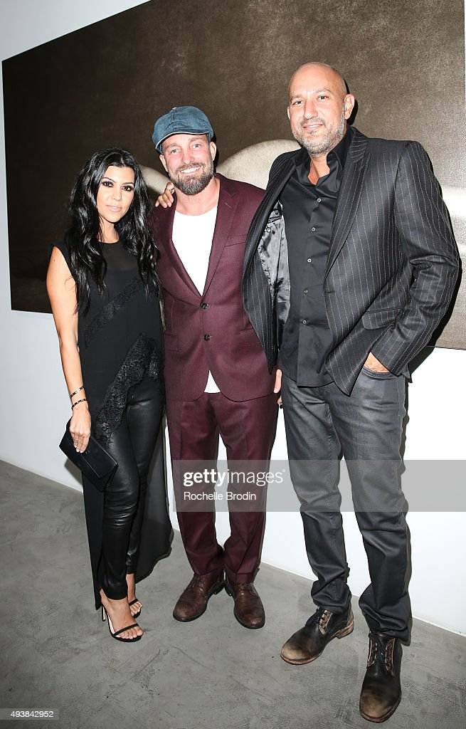 TV personality Kourtney Kardashian, Brian Bowen Smith and Steph Sebbag attend 'Metallic Life' by Brian Bowen Smith, brought to you by CASAMIGOS Tequila at De Re Gallery on October 22, 2015 in West Hollywood, California.