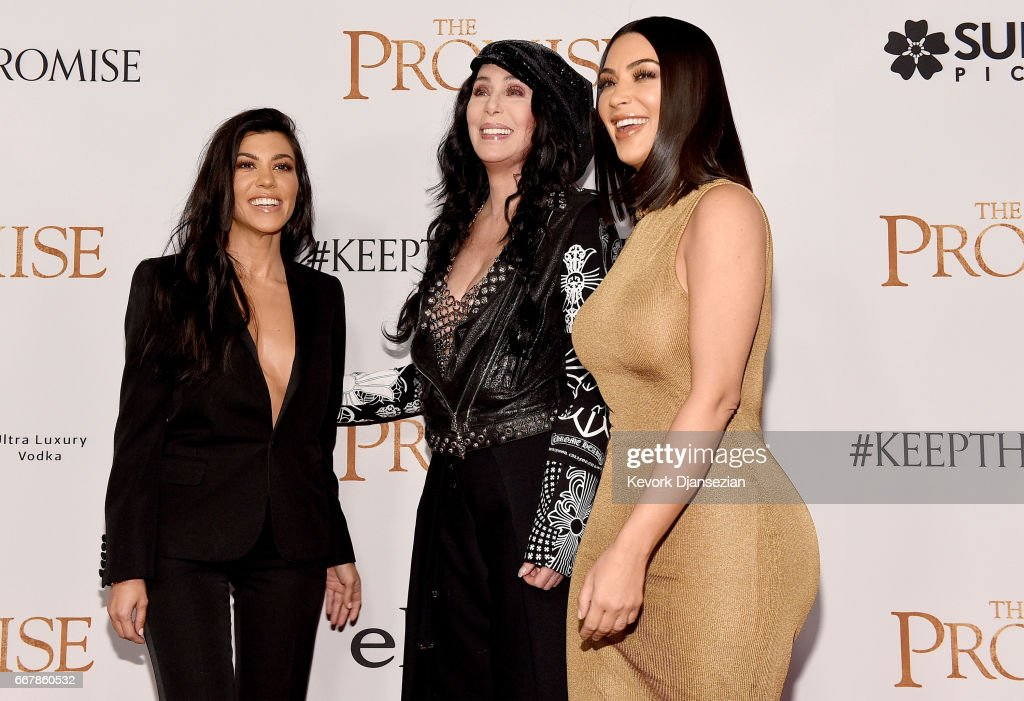 TV personality Kourtney Kardashian, singer/actor Cher, and TV personality Kim Kardashian West attend the premiere of Open Road Films' 'The Promise' at TCL Chinese Theatre on April 12, 2017 in Hollywood, California.