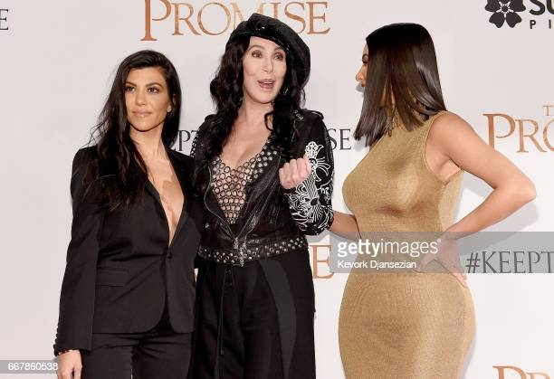 TV personality Kourtney Kardashian singer/actor Cher and TV personality Kim Kardashian West attend the premiere of Open Road Films' The Promise at...