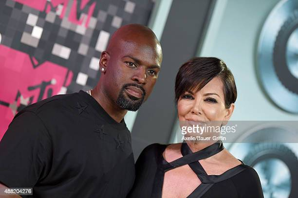TV personality Kris Jenner and Corey Gamble arrive at the 2015 MTV Video Music Awards at Microsoft Theater on August 30 2015 in Los Angeles California