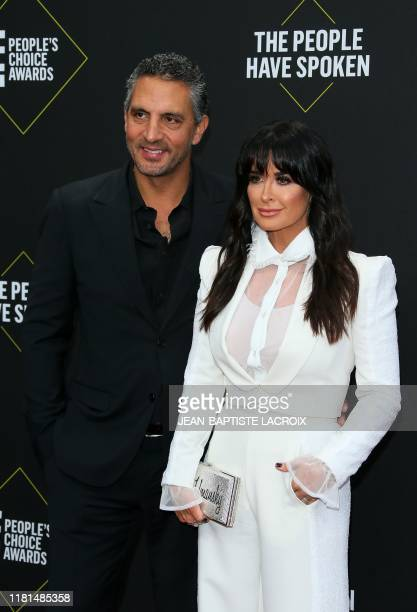 US TV personality Kyle Richards and her husband real eastate agent Mauricio Umansky arrive for the 45th annual E People's Choice Awards at Barker...