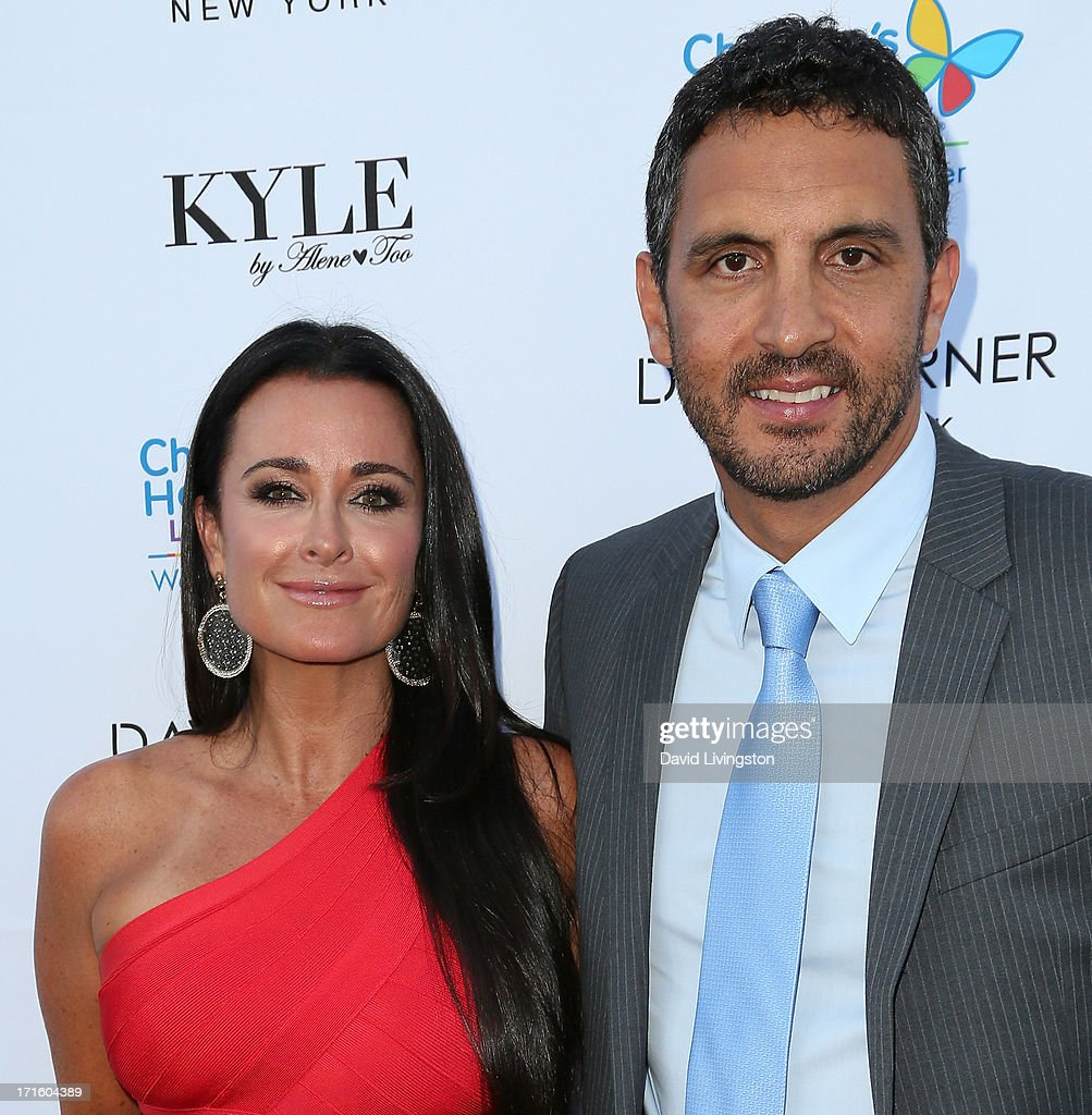 TV personality Kyle Richards (L) and husband Mauricio Umansky attend a fashion fundraiser benefitting Children's Hospital of Los Angeles hosted by Kyle Richards at Kyle by Alene Too on June 26, 2013 in Beverly Hills, California.