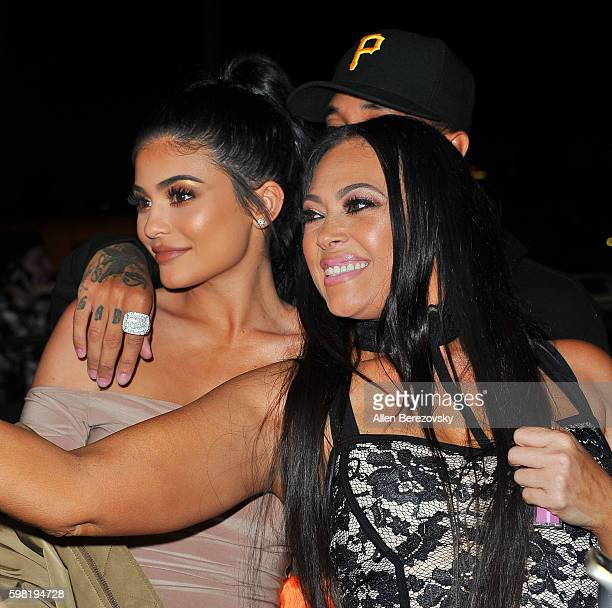 TV personality Kylie Jenner rapper Tyga pose for a selfie with a guest during Boohoo X Jordyn Woods Fashion Event at NeueHouse Hollywood on August 31...