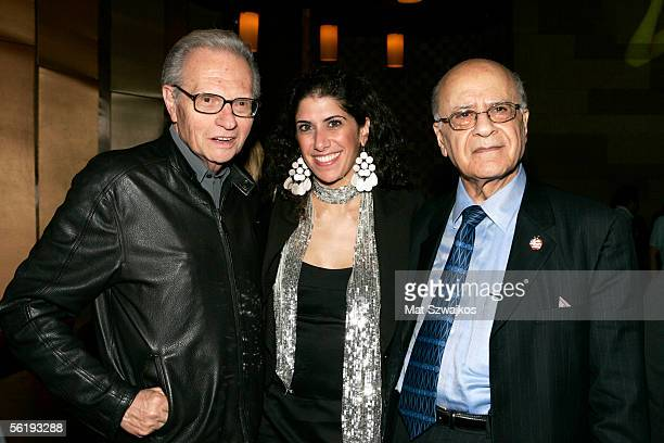 CNN TV personality Larry King Monalisa Mouallem and Dr Amid Mouallem pose at the listening party for Shawn King's new CD 'In My Own Backyard' hosted...
