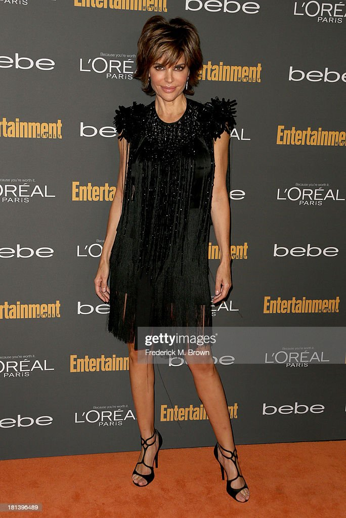TV personality Lisa Rinna arrives at Entertainment Weekly's Pre-Emmy Party at Fig & Olive Melrose Place on September 20, 2013 in West Hollywood, California.