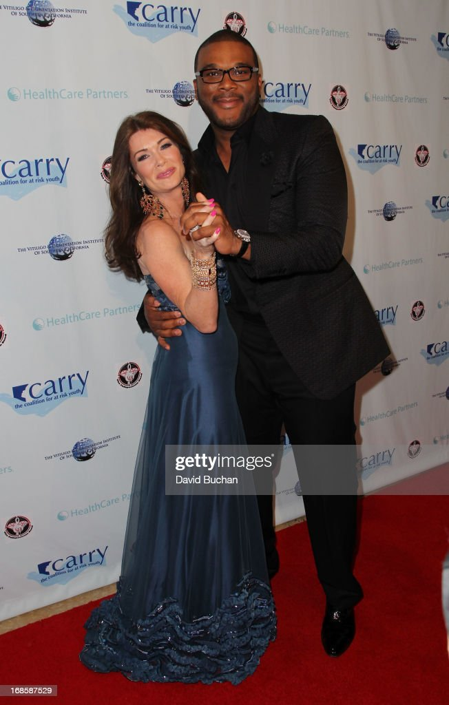 TV personality Lisa Vanderpump and actor/director Tyler Perry attend The Coalition For At-Risk Youth (CARRY) 'Shall We Dance' Gala at The Beverly Hilton Hotel on May 11, 2013 in Beverly Hills, California.