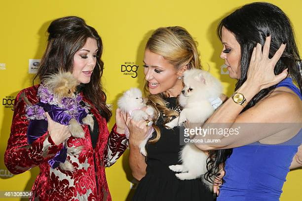 TV personality Lisa Vanderpump and her dog Giggy socialite Paris Hilton and her dogs Princess Paris Jr and Prince Hilton and socialite Allison...