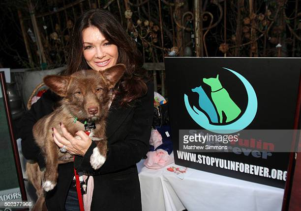 Personality Lisa Vanderpump poses with a dog that was rescued from the Yulin dog meat festival during a press conference at PUMP Restaurant on...