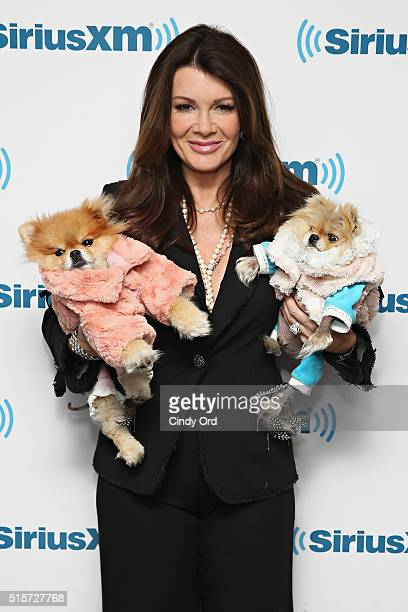 TV personality Lisa Vanderpump poses with her dogs Harrison and Giggy during a visit to the SiriusXM Studio on March 15 2016 in New York City