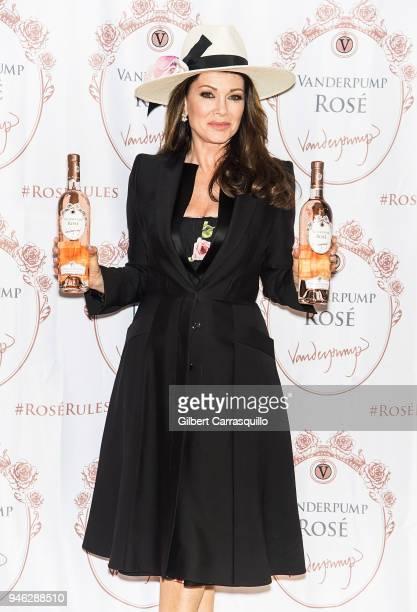 TV personality Lisa Vanderpump signs bottles of Vanderpump Rose at the Fine Wine Good Spirits Premium Collection store on April 14 2018 in Ardmore...