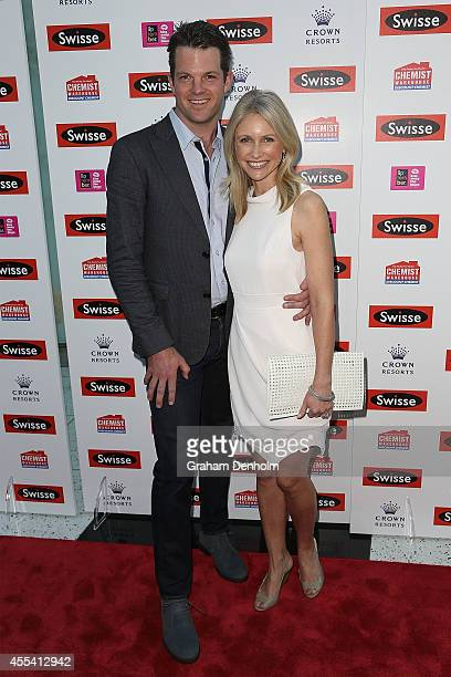 TV personality Livinia Nixon and Alistair Jack pose on the red carpet prior to the Robbie Williams performance at the Palms at Crown on September 14...