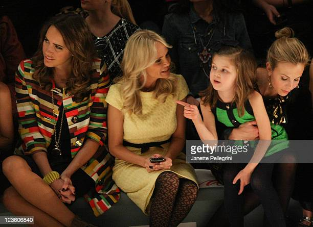 TV Personality Louise Roe Actress Kristen Chenoweth and Elizabeth Hasselbeck with daughter Grace Elizabeth Hasselbeck attend the Milly by Michelle...