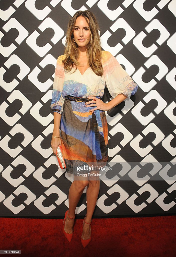 TV personality Louise Roe arrives at Diane Von Furstenberg's 'Journey Of A Dress' premiere opening party at Wilshire May Company Building on January 10, 2014 in Los Angeles, California.