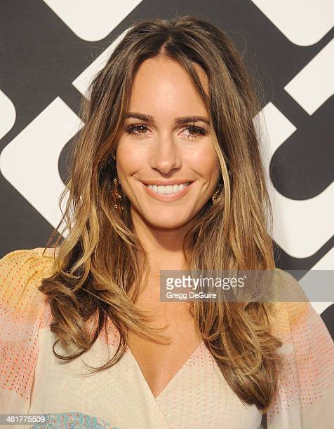 TV personality Louise Roe arrives at Diane Von Furstenberg's 'Journey Of A Dress' premiere opening party at Wilshire May Company Building on January...