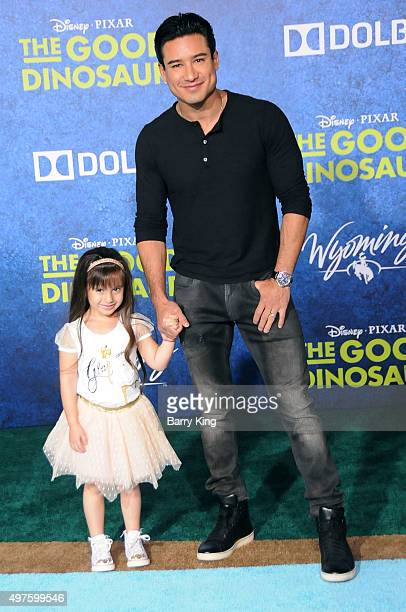 Personality Mario Lopez and daughter Gia Francesca Lopez attend the Premiere of Disney-Pixar's 'The Good Dinosaur' at the El Capitan Theatre on...